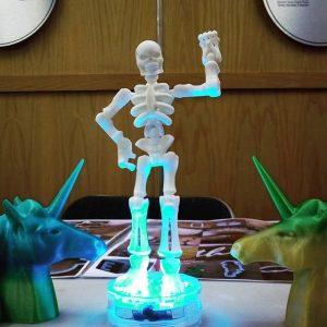 3D Printed Skeleton, in white stood on led lighting